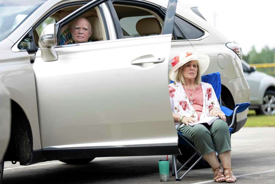 Lee (left) and Carole Fox (right) follow along a church sermon gives by Senior Pastor Dave Schneider at Conroe Bible Church, Sunday, April 12, 2020. Easter services held in a drive-in style service where parishioners stayed in their vehicles due to COVID-19. Photo: Gustavo Huerta, Houston Chronicle / Staff Photographer / Houston Chronicle © 2020