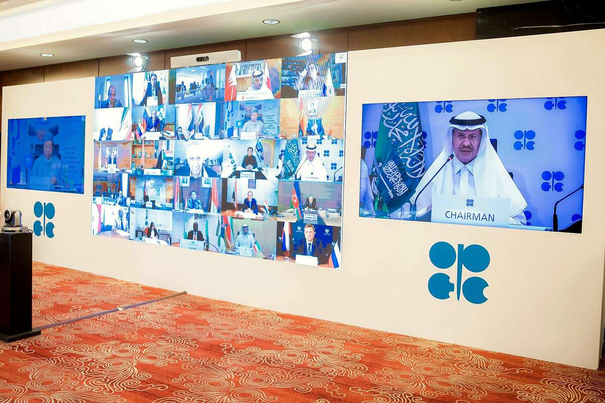 A handout photo released by the Saudi Press Agency (SPA) on April 9, 2020 in Riyadh shows Saudi Energy Minister Prince Abdulaziz bin Salman al-Saud (R), chairing the virtual meeting of the virtual extraordinary meeting of Organisation of the Petroleum Exporting Countries (OPEC) and non-OPEC countries, amid the novel coronavirus pandemic.