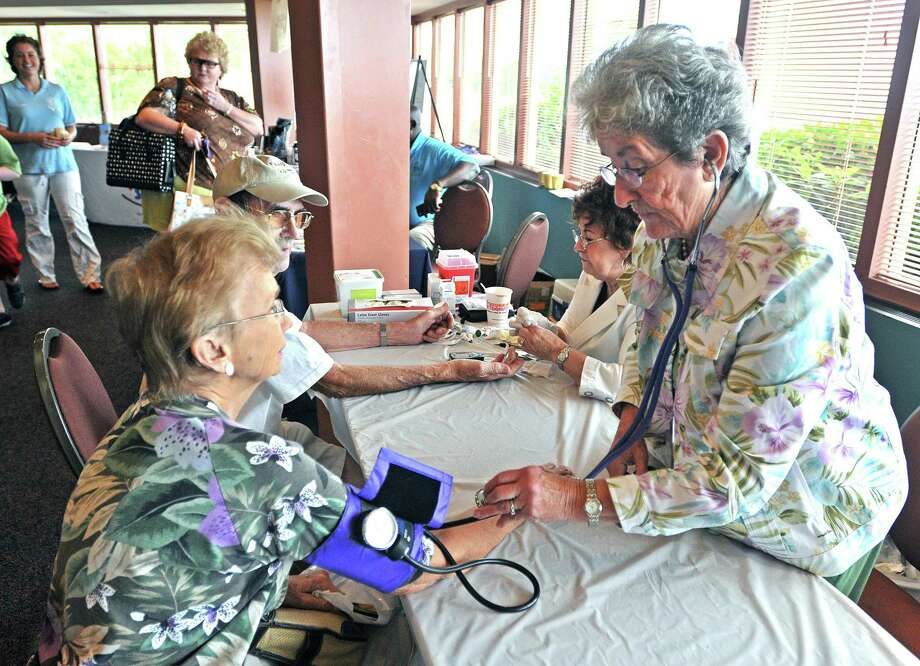 In this file photo, then volunteer RN, Mary Radziszewski, checks a blood pressure at a West Haven Health Fair. Photo: Peter Casolino / Hearst Connecticut Media File Photo