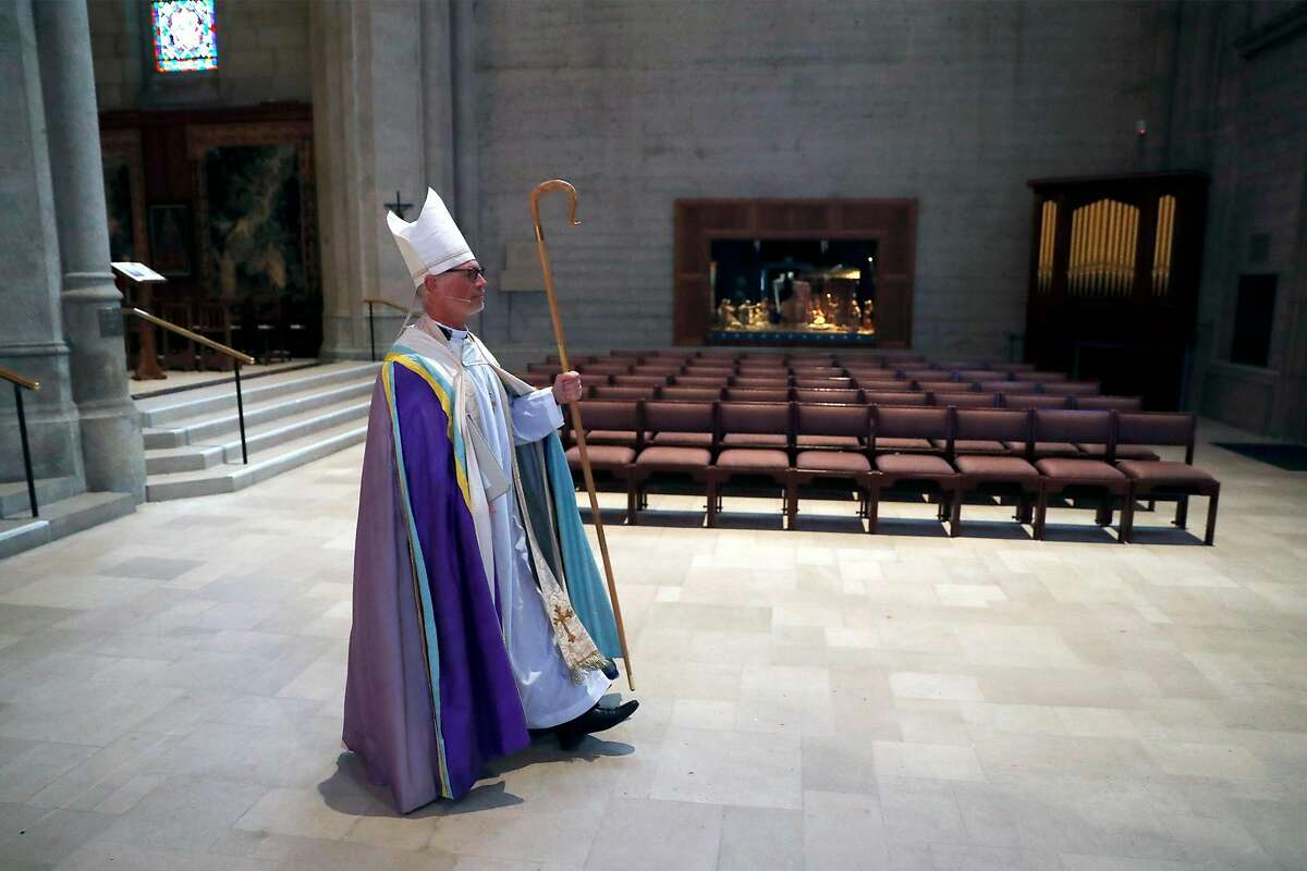 Bishop Marc Andrus processes to altar during virtual Easter Sunday service at Grace Cathedral in San Francisco, Calif., on Sunday, April 12, 2020.