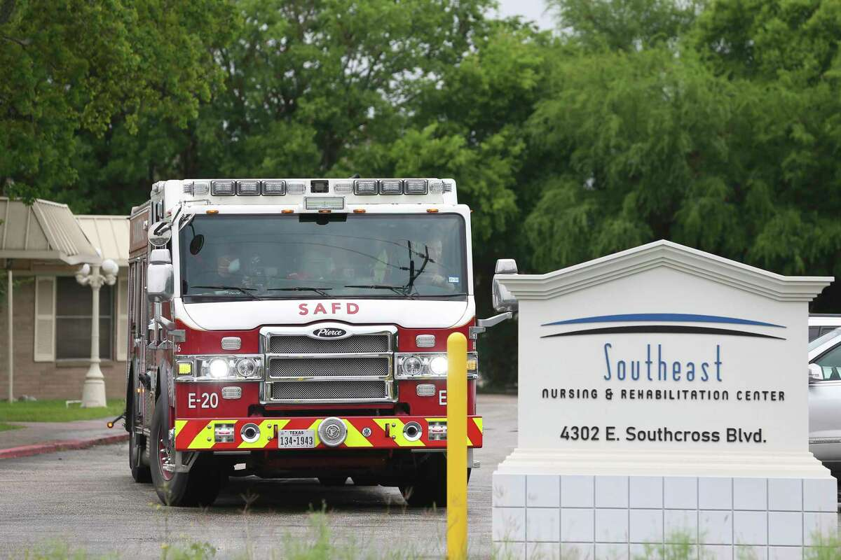 A San Antonio Fire Department truck leaves the Southeast Nursing and Rehabilitation Center on April 3. The fire department has had to make frequent emergency runs to the facility to take residents to the hospital; more than 70 of the 84 residents have tested positive for COVID-19 and 14 have died. More than 25 employees at the nursing home also have tested positive, officials say.