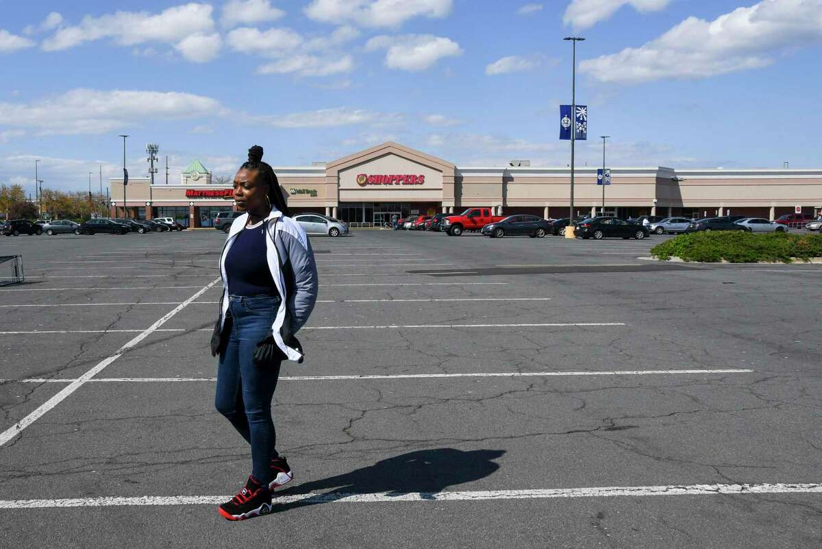 Shoppers employee Amber Stevens, 30, poses outside a store in Forestville, Maryland.