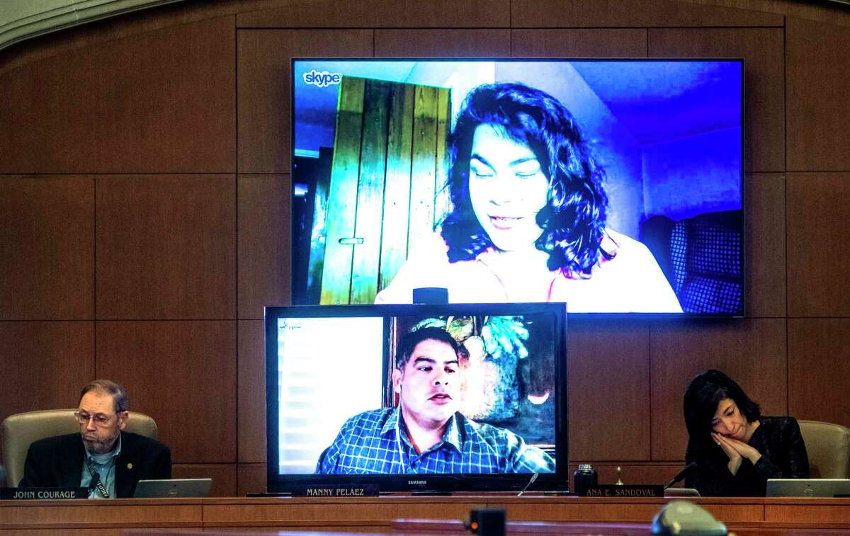 San Antonio City Council members Rebecca Villagran, top, and Manny Pelaez, who at the time were in quarantine due to possible exposure to the coronavirus, are seen on monitors as they participate in a council meeting March 26 via video conferencing. Seated at the dais in person are Councilman John Courage, left, and Councilwoman Ana Sandoval.