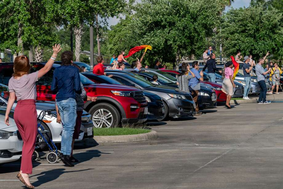Church members react to the music with joy at the drive-in Easter service at the Anchor of Beaumont after not being able to see one another for several weeks. Photo made on April 12, 2020. Fran Ruchalski/The Enterprise Photo: Fran Ruchalski/The Enterprise / ? 2020 The Beaumont Enterprise