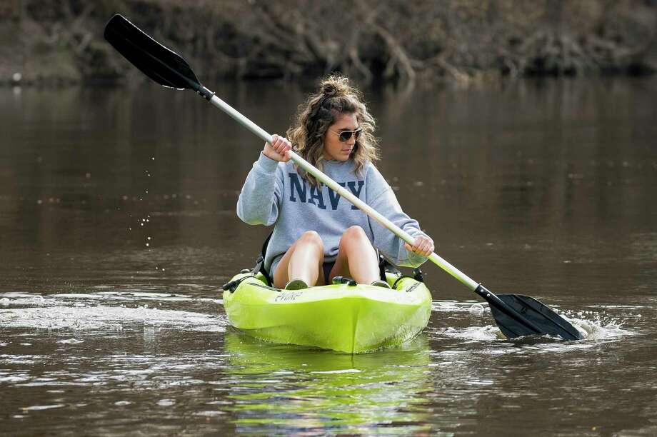 Springing into action Haley Sisitki paddles a kayak underneath the Tridge Wednesday. (Adam Ferman/for the Daily News)