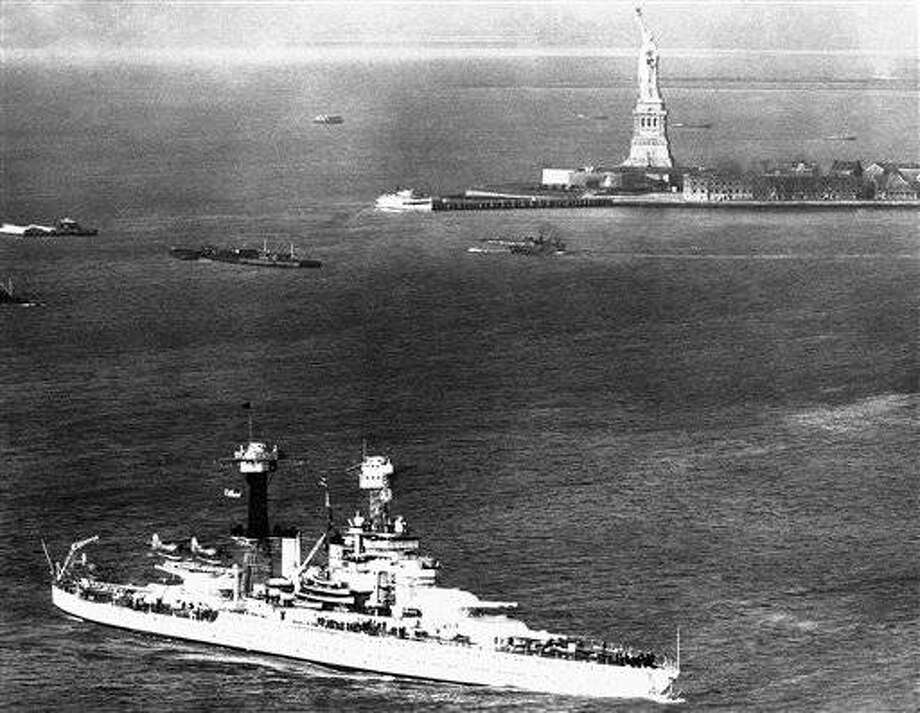 The US Battleship Tennessee makes a majestic picture as she steams into New York harbour, on April 13, 1939, passing the Statue of Liberty. (AP Photo)