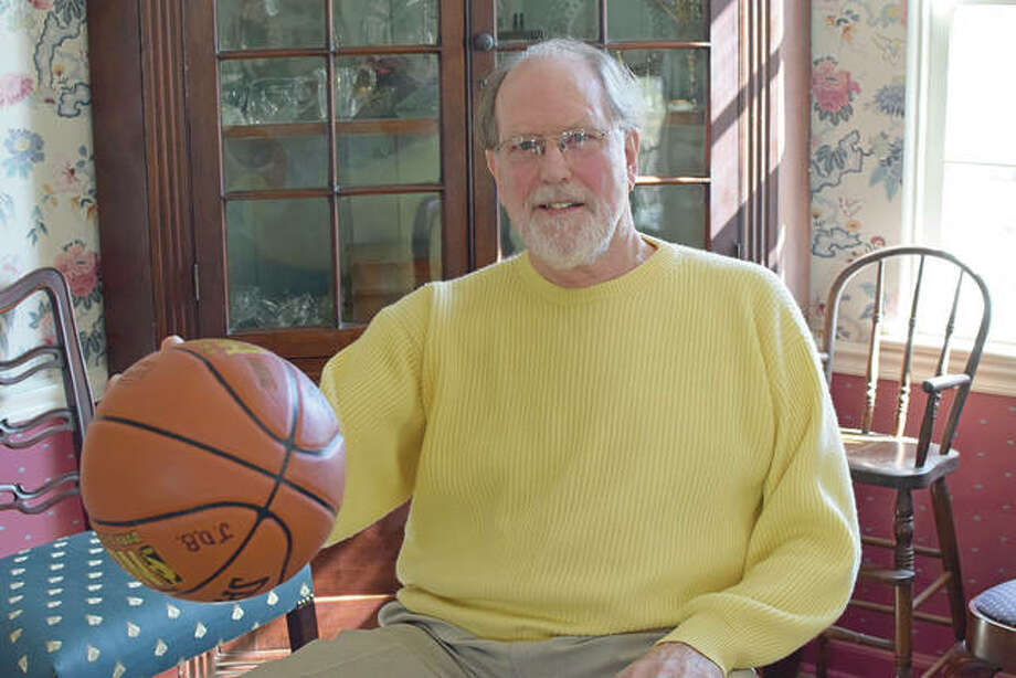 David Bone in his Jacksonville home, showing he can still palm a basketball. Photo: David Blanchette | Journal-Courier