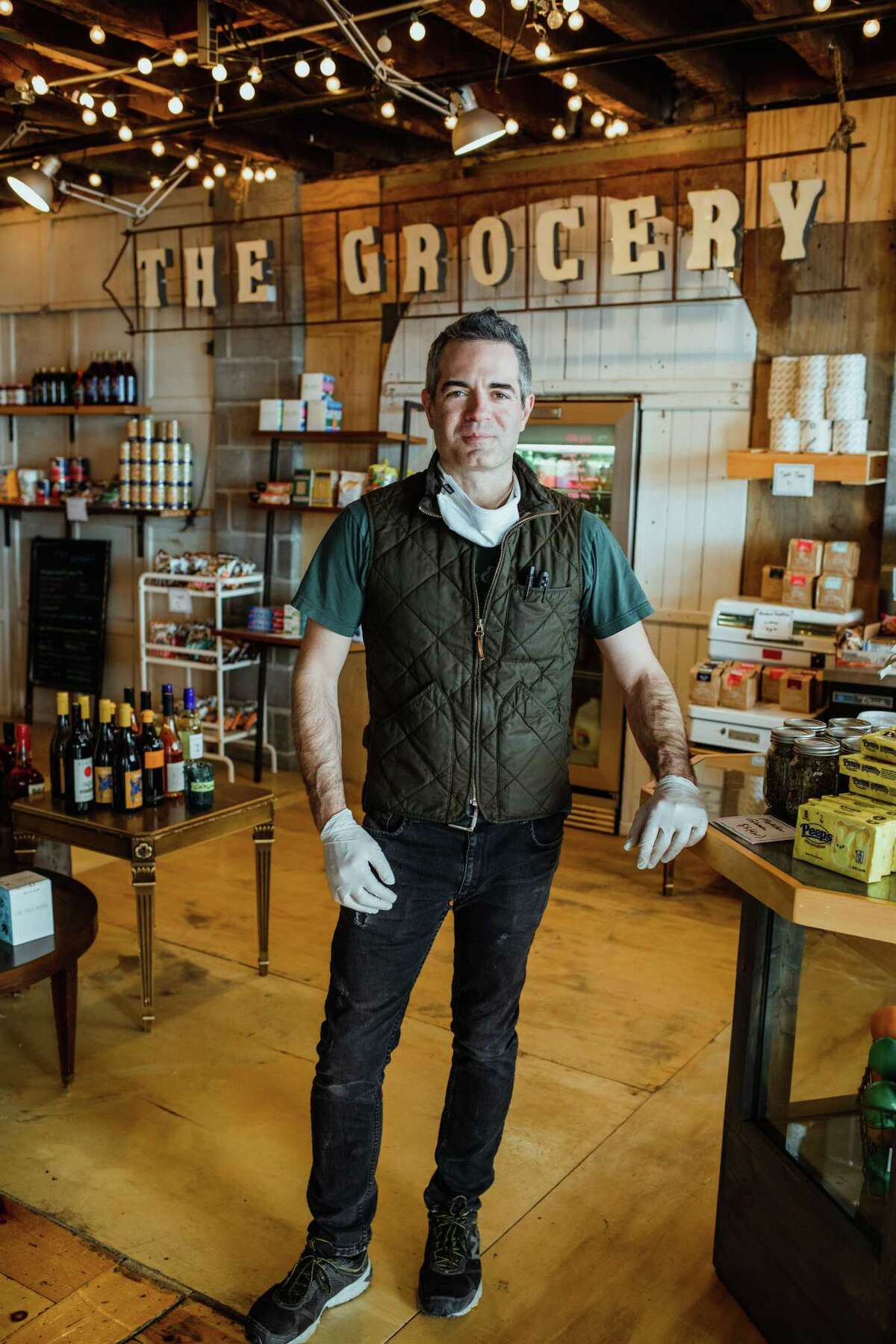 Vic Christopher, owner of Clark House Hospitality in Troy, shown in April of this year in an area of the company's Little Peck's cafe that has been turned into a small market. Little Pecks is within the larger Clark House building, at 207-217 Broadway. (Photo by Konrad Odhiambo.)