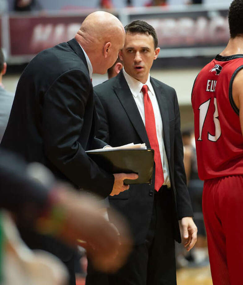 SIUE coach Brian Barone (middle) talks to assistant Mike Waldo during a game last season at First Community Arena in Edwardsville.