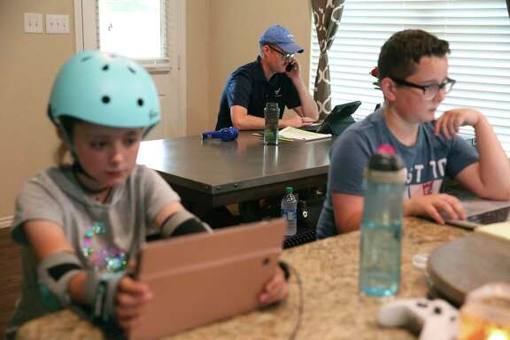 Air Force recruiter Master Sgt. William Magill works out of his New Braunfels house in April while his kids take part in distance learning. Readers weigh in about the safety of the upcoming school year.