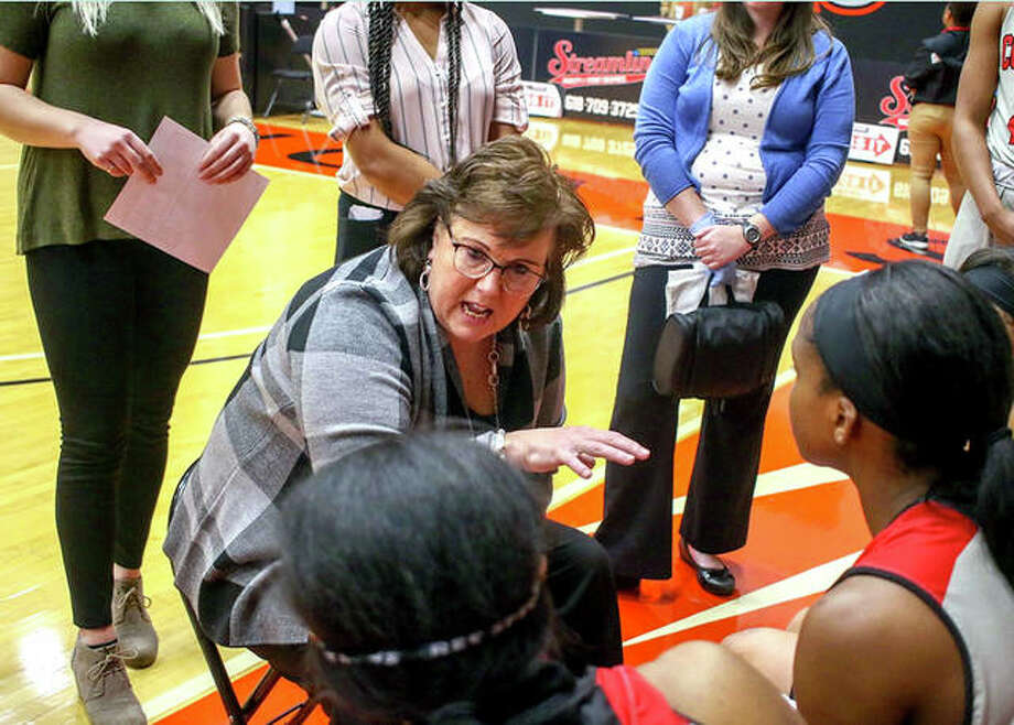 SIUE coach Paula Buscher talks to her Cougars during a timeout during a regular-season game inside the Vadalabene Center. Photo: SIUE Athletics