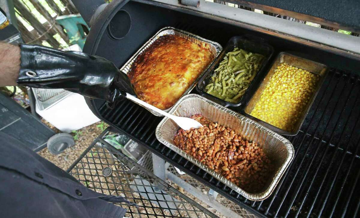 Baked beans, mac and cheese, corn and green beans are tested to see if they are suitable for smoking at Chuck's Food Shack.