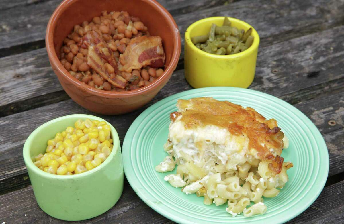 Baked beans, mac and cheese, corn and green beans were tested in the smoker to determine which classic barbecue side picked up the most smoke.