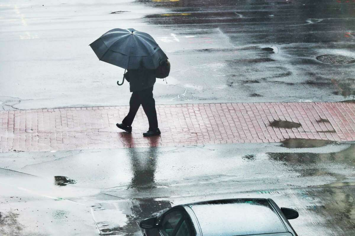 Keep that umbrella - and maybe an insulated coat - handy. Times Union meteorologist Jason Gough says we're in for a stretch of cool temperatures and steady rain until at least next week. A man makes his way down Fourth St. as rain falls on Monday, April 13, 2020, in Troy, N.Y. (Paul Buckowski/Times Union)