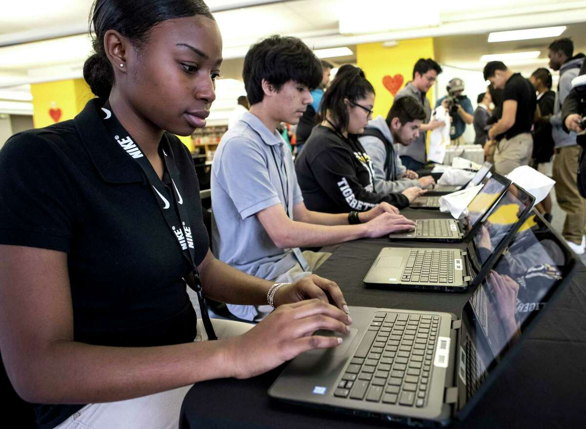 In this 2018 file photo, Bre'Nira Fuller takes a survey on a laptop after receiving her new Sprint wireless internet hotspot device provided by the 1Million Project Foundation at Houston ISD's Sam Houston Math, Science & Technology Center. While many high school students already use hotspots in HISD, district officials are trying to buy more devices for students in lower grades during the novel coronavirus pandemic.