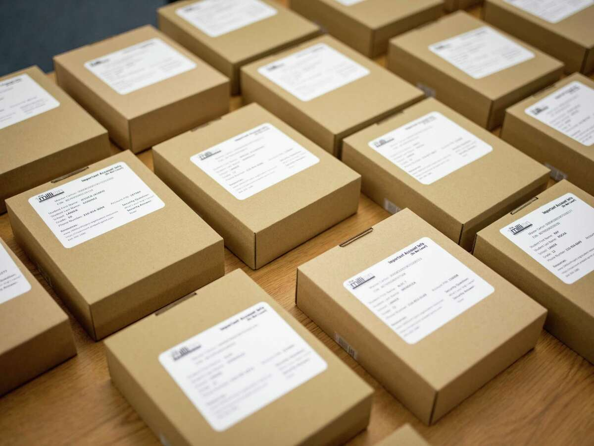 In this 2019 file photo, hotspot devices provided by the 1Million Project Foundation sit ready to be delivered for free to high school students at Sidney Lanier High School in San Antonio. School districts across the country are scrambling to buy hotspots during the novel coronavirus pandemic, straining a supply chain that will take multiple months to fill some orders.