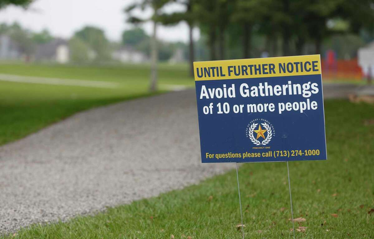 A sign warning people not to gather at Tom Bass Regional Park III Wednesday, April 8, 2020, in Houston.