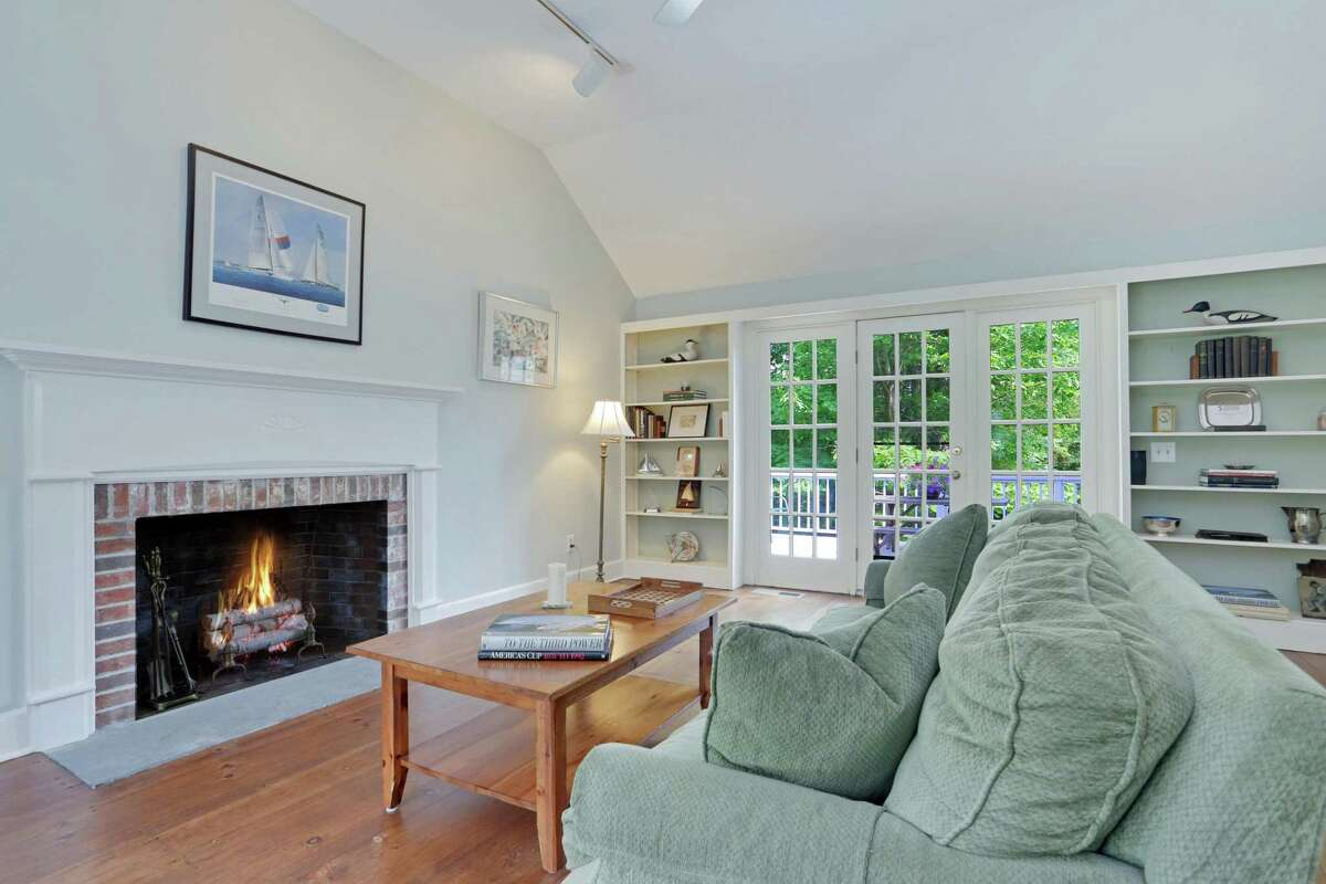The family room has a fireplace, vaulted ceiling, built-in bookshelves, and French doors to the deck.
