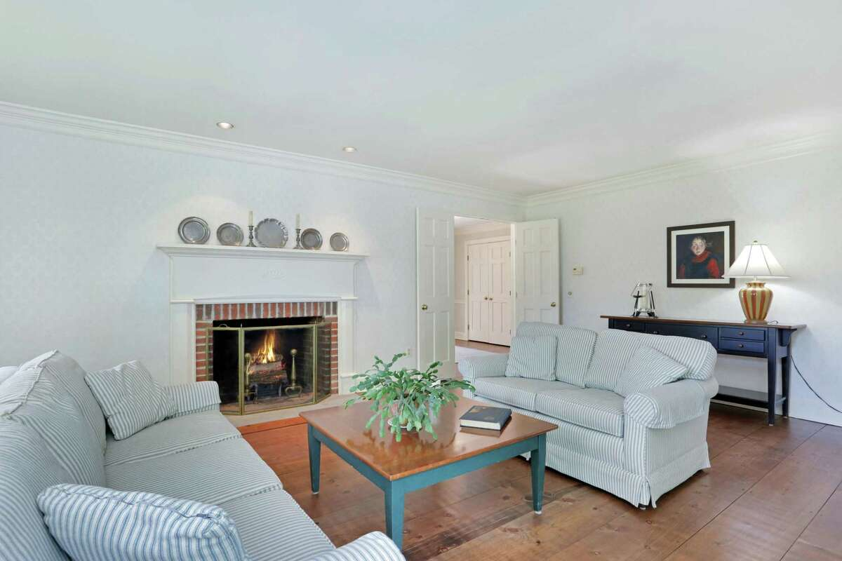 The formal living room has a fireplace, wet bar, and French doors to a raised deck.