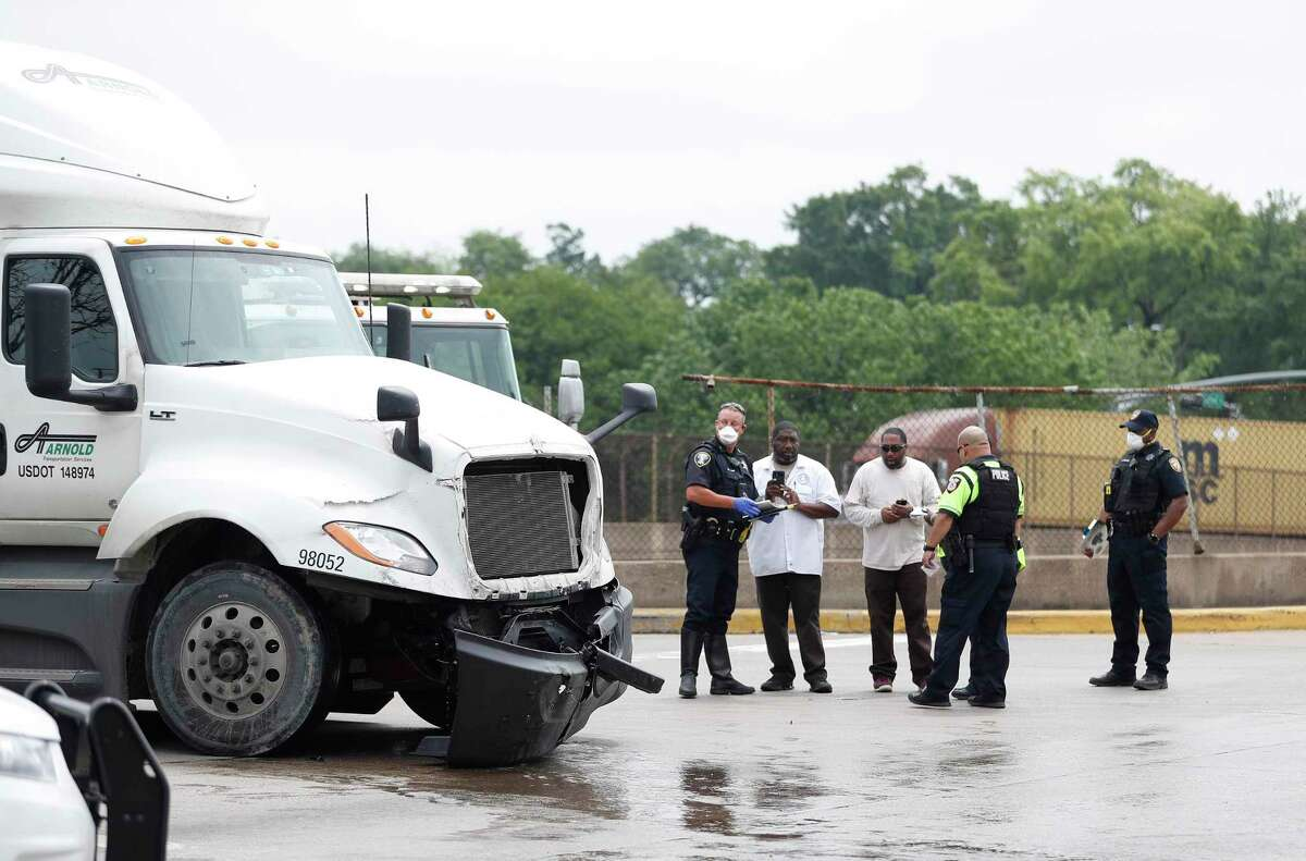 Metro Police and Houston Police investigate the scene of a crash between an 18-wheeler and a Metropolitan Transit Authority bus at Lockwood and the frontage road of Interstate 10 in the Fifth Ward, in Houston on April 8, 2020. An unknown number of people were taken off the bus and put into ambulances, with unknown injuries.