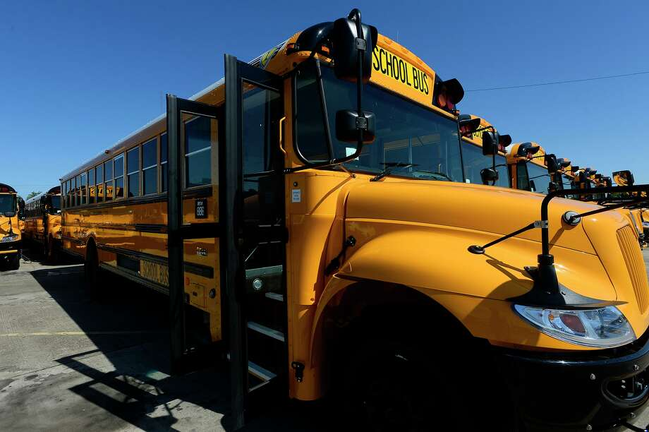 Beaumont ISD has 30 of the 97 planned new school buses at their transportation center on Thursday afternoon. The district's new buses all have air conditioning, seat belts and camera systems.  Photo taken Thursday 4/27/17 Ryan Pelham/The Enterprise Photo: Ryan Pelham / Ryan Pelham/Ryan Pelham/The Enterprise / ©2017 The Beaumont Enterprise/Ryan Pelham