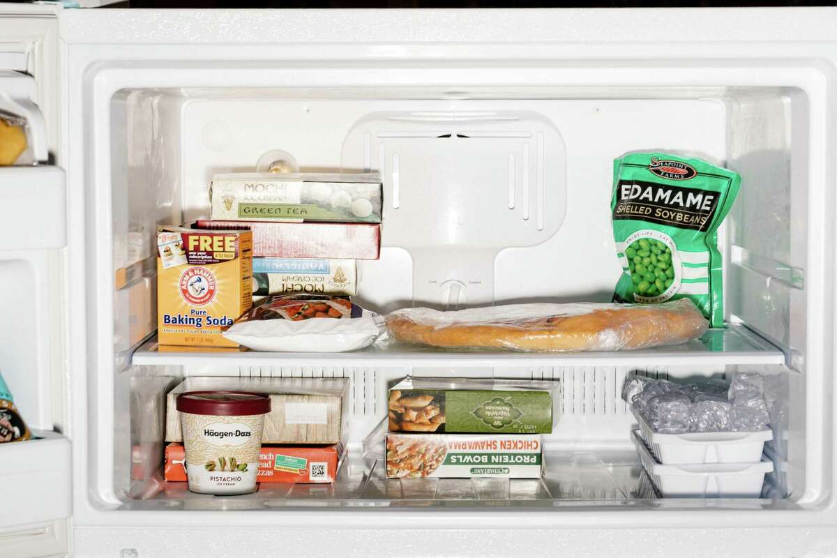FILE - A freezer full of food at the Museum of Modern Art in San Francisco, March 27, 2019. Whether it?•s a tiny top-of-the-fridge box in your kitchen, or a commodious separate chest freezer in the garage, organizing and stocking it wisely is the key to keeping the greatest variety of ingredients on hand. (Jason Henry/The New York Times)