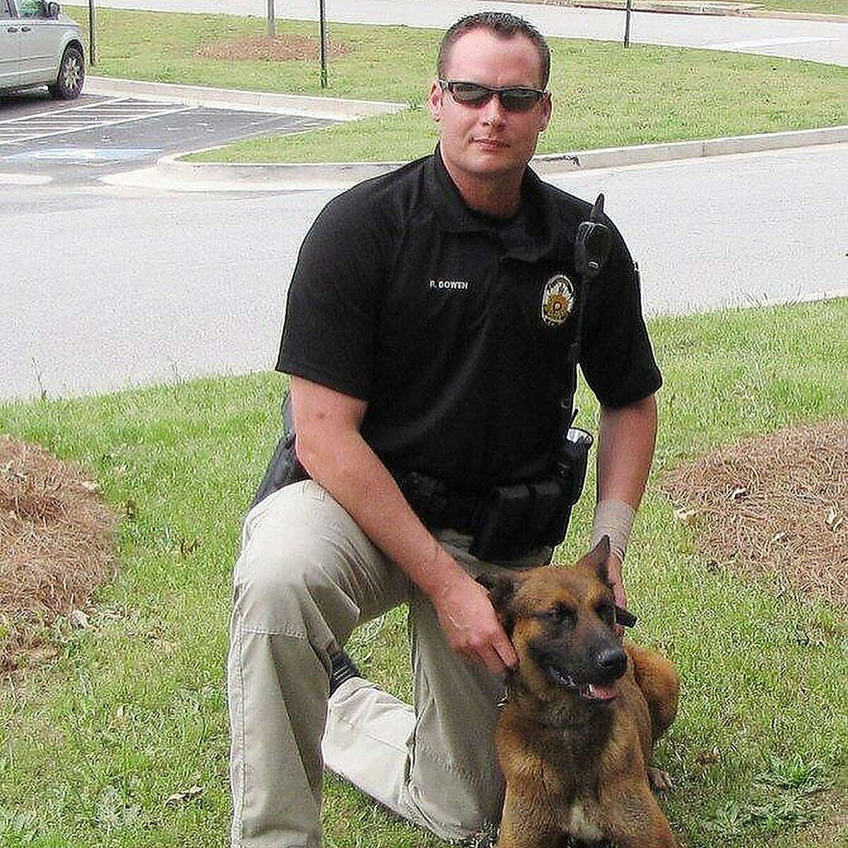 Former A's catcher Rob Bowen works with his first K9 partner, Jester, in Henry County, Ga.