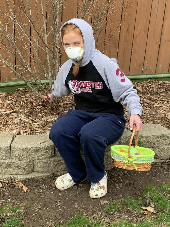Freeland's Alli Shea participates in an Easter egg hunt outside her mother's home on Sunday. (photo provided)