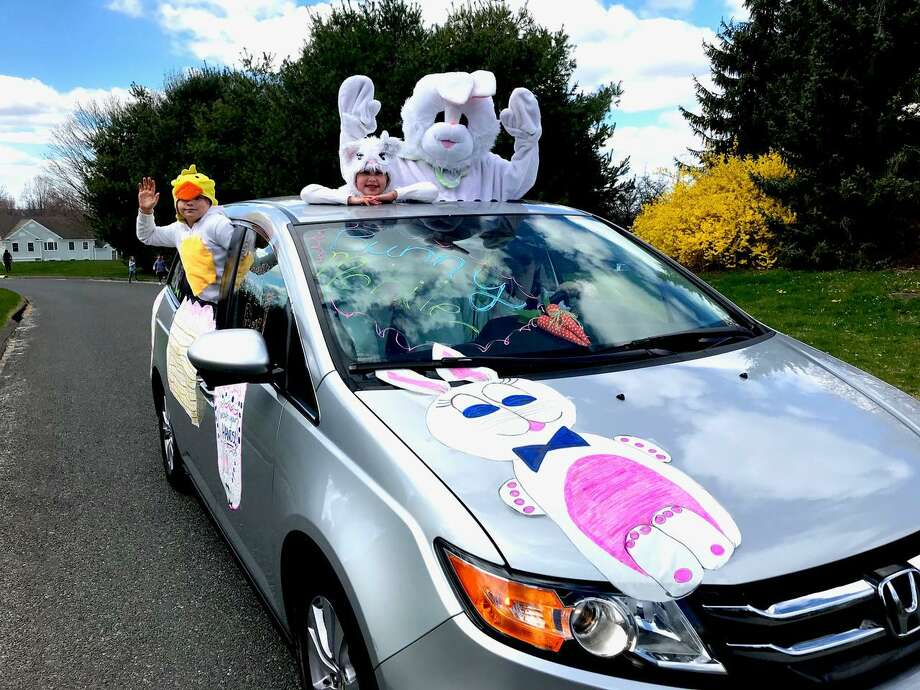 The Easter Bunny, sticking his head up from the sunroof, along with a baby bunny and duckling drove through the streets of Sandy Hook on the weekend. No candy nor plastic Easter eggs were tossed from the van. He just wanted to wave hello to everyone. Photo: Contributed Photo / Lois Barber