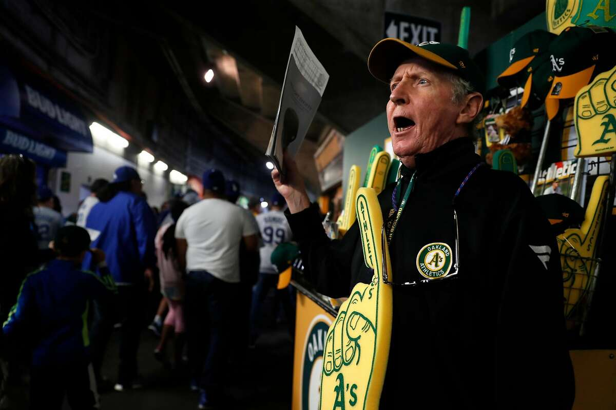 Oakland Athletics' vendor Tim Begley, who has worked at the Oakland Coliseum for the past 39 years, hawks programs and souvenirs before A's game against the Los Angeles Dodgers in Oakland, Calif. on Wednesday, August 8, 2018.
