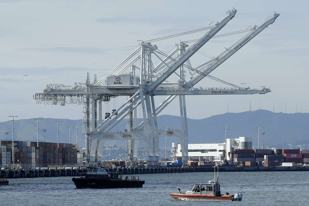 Cranes are shown at the Port of Oakland in Oakland, Calif., Tuesday, March 10, 2020. (AP Photo/Jeff Chiu)