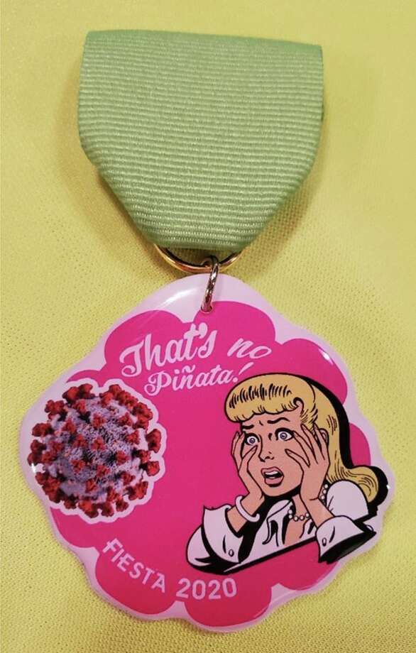 "Heart of Texas Promotional Products, or FiestaMedals.com, is the company behind the new ""That's No Piñata"" medal. The pop art-like medal shows a woman in distress, looking at a graphic of the spiky virus that has now become etched in millions of minds. Each medal comes with a free key chain attachment. Photo: Heart Of Texas Promotional Products"