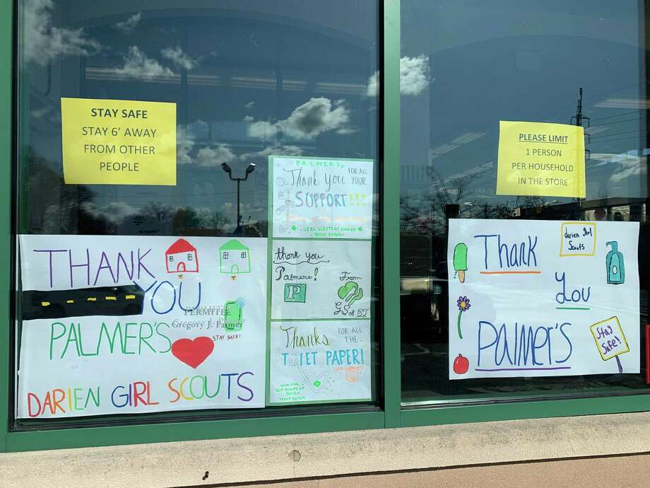 Darien Girl Scouts created thank you signs for Palmer's front window. These were made by Lauren Devens and Cynthia Clough's eighth grade Girl Scout troop 50469. That troop also made signs for Post 53. Photo: Darien Girl Scouts /