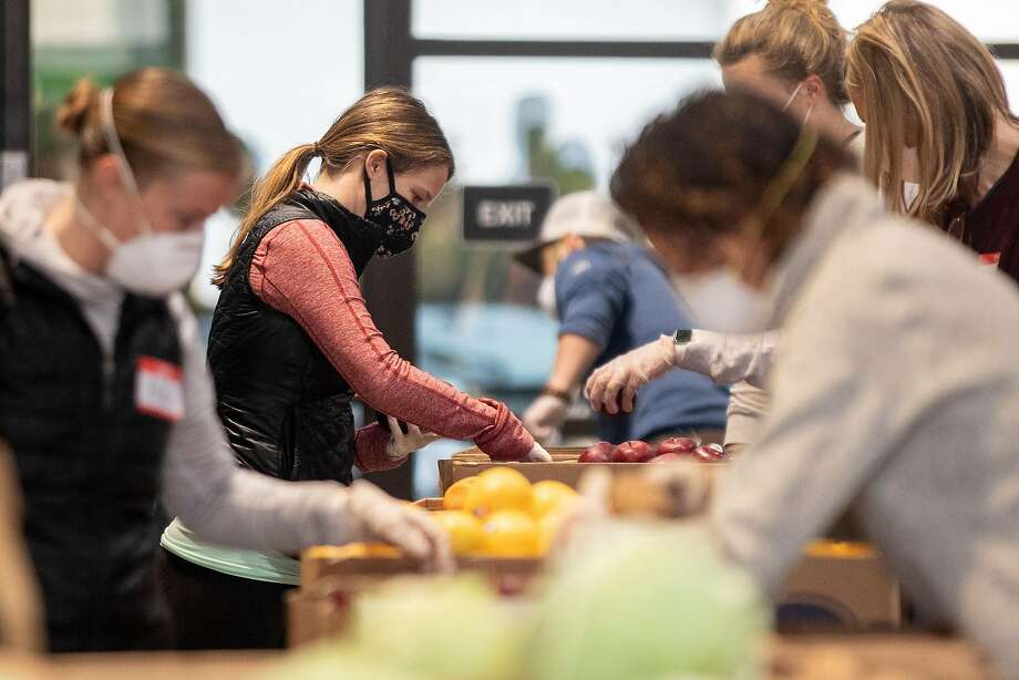 A new fundraising effort to help food banks across Washington as they see dwindling supplies during the novel coronavirus outbreak brought in more than $800,000 in its first week. Photo: Photos By Jessica Christian / The Chronicle