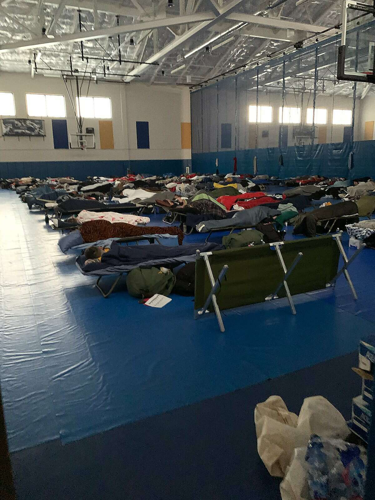 There were more than 350 infected Theodore Roosevelt sailors in a Guam gym used as group quarantine on Friday. On Wednesday, there had been less than 50, said Mark Blakewood, whose son is there.