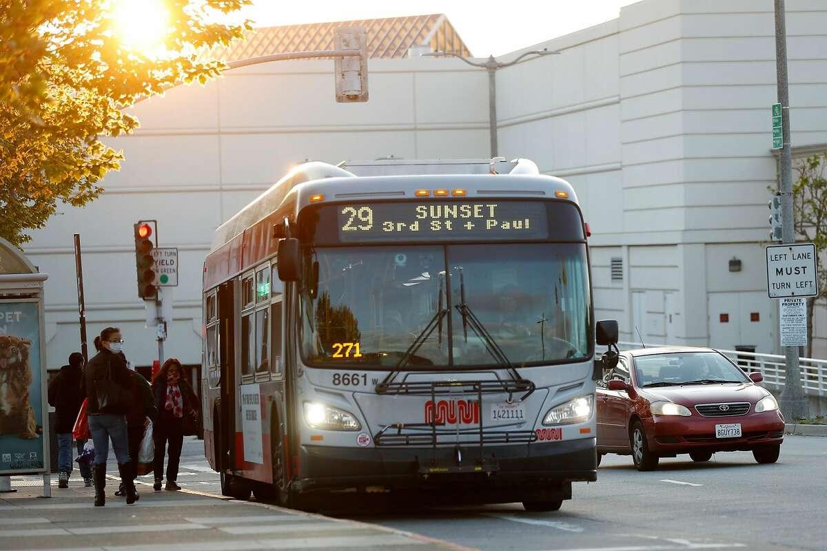 A MUNI bus picks up riders at Stonestown Galleria in San Francisco, Calif., on Thursday, April 9, 2020.
