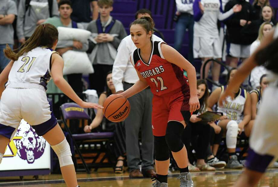 Tomball junior Eliza Lehmann (22) works the ball against Montgomery senior Lindsey Hefner (21) during their district matchup at MHS on Dec. 6, 2019. Photo: Jerry Baker, Houston Chronicle / Contributor / Houston Chronicle