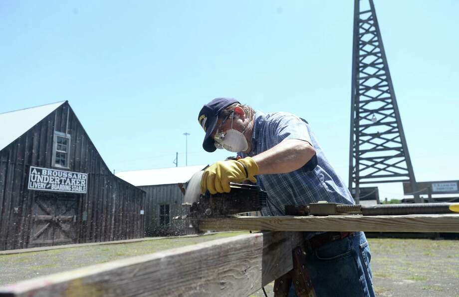 Don Smart cuts boards as he continues work on replacing walkways in need of repair at Spindletop-Gladys City Boomtown Museum Monday, April 13. Museum director Troy Grey says he and staff, including Smart, have been using their time closed due to the Stay at Home orders to catch up on maintenance and repair projects and to document objects in storage at the museum. Photo taken Monday, April 13, 2020 Kim Brent/The Enterprise Photo: Kim Brent / The Enterprise / BEN