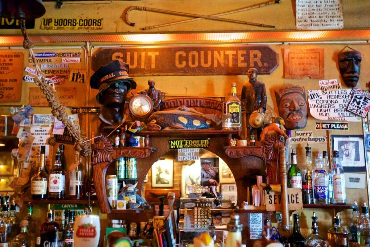 The walls of Specs' bar in North Beach are cluttered with hundreds of quirky artifacts and signs.