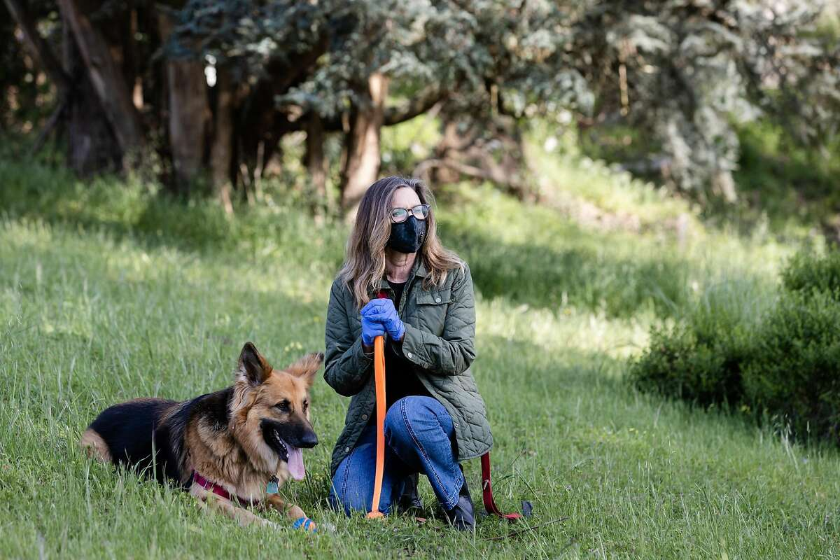 Christina Pappas and her dog Lassen spend time at Mountain Lake Park on Monday, April 13, 2020, in San Francisco, Calif.