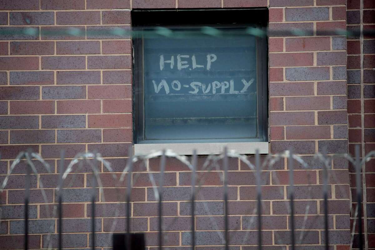 Harris County Sheriff Ed Gonzalez is working hard to thin the jail population so it won't become a hot spot for the coronavirus as other large urban jails have around the country. Here, a sign pleading for help hangs in a window at the Cook County jail complex on April 09, 2020 in Chicago, where nearly 400 cases of COVID-19 have been diagnosed among the inmates and employees.