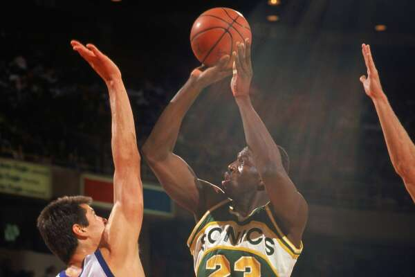 DENVER - 1990: Olden Polynice #23 of the Seattle Supersonics shoots a jump shot over Blair Rasmussen #41 of the Denver Nuggets during a game in the 1989-1990 NBA season at McNichols Sports Arena in Denver, Colorado. (Photo by Tim Defrisco/Getty Images)