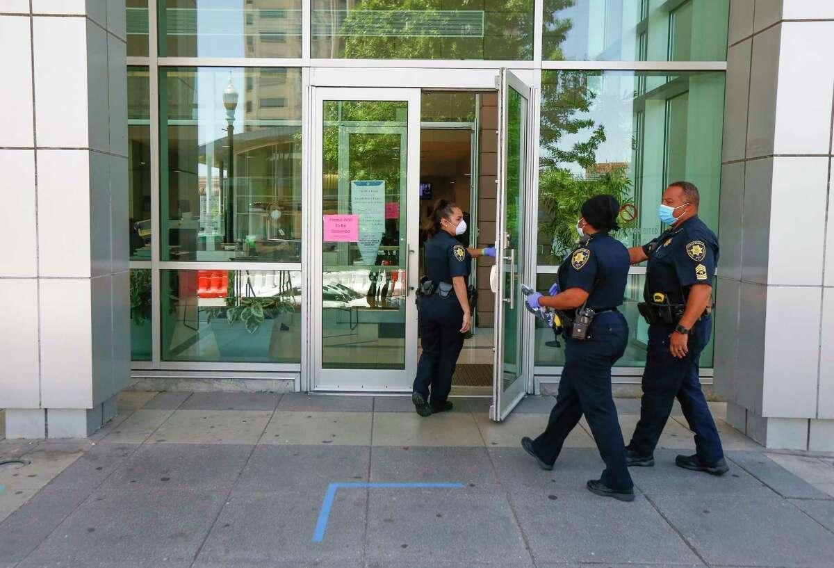 Precinct 1 Constables enter the Harris County Juvenile Justice Center Monday, April 13, 2020, in Houston.