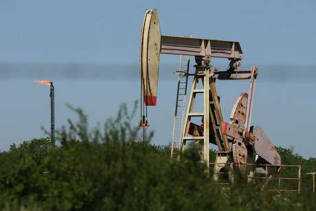 The Securities and Exchange Commission has sue three Texans for allegedly selling $2.7 million in fraudulent oil and gas investments in Wilson County. Pictured is a pump jack operating in Wilson County.
