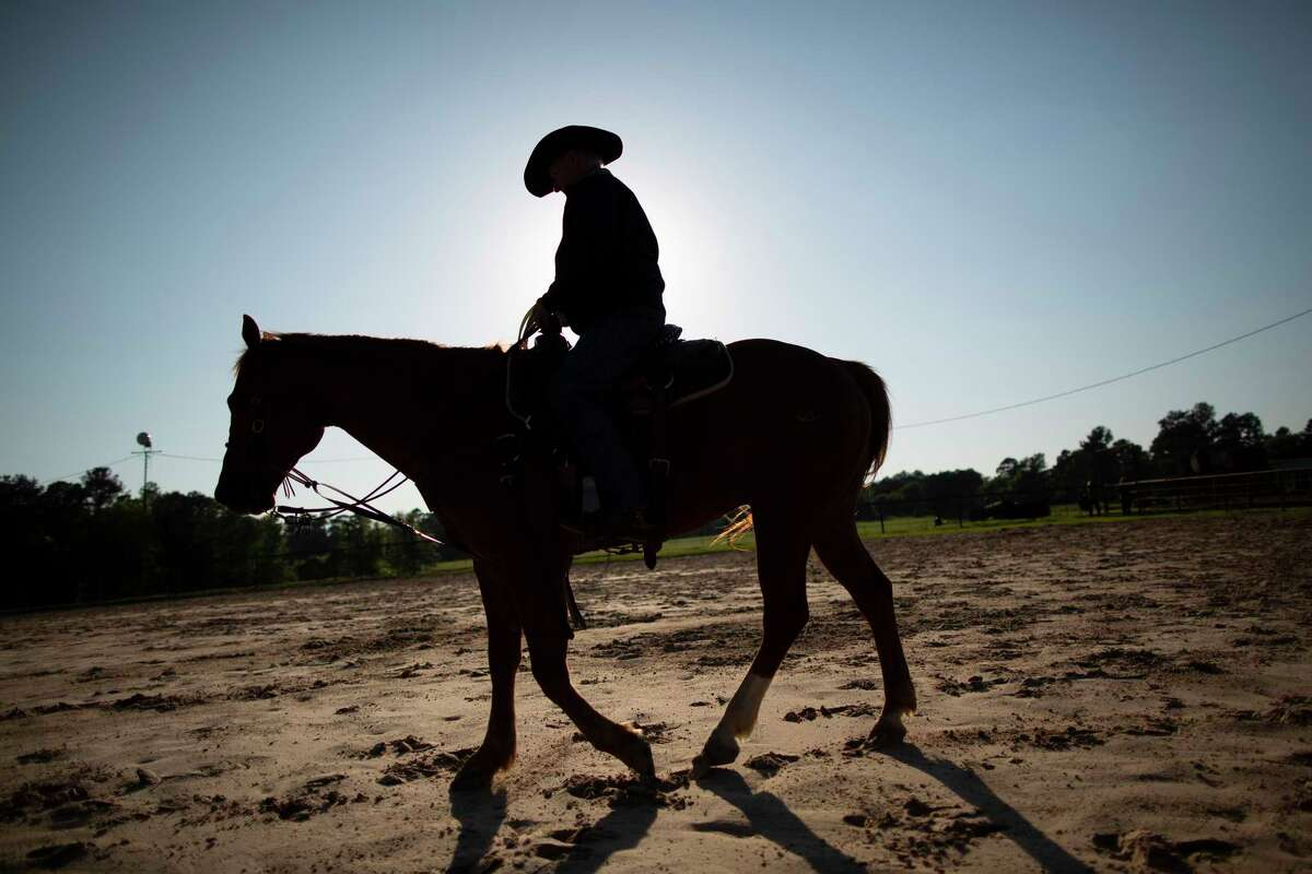Houston County Judge Jim Lovell prepares to team rope with his son Justin Lovell at the family's ranch on Monday, April 13, 2020, in Weches. The judge said jokingly that these is how families practice social distancing during the COVID-19 outbreak.