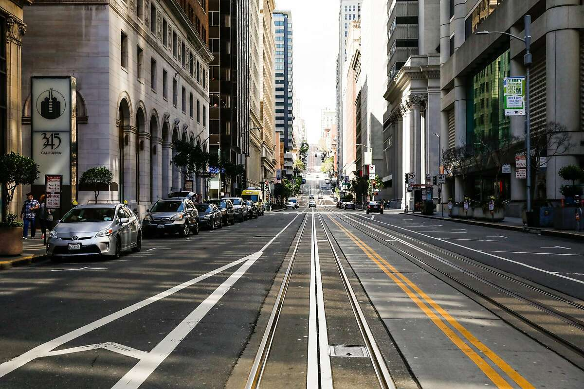 California Street is unusually empty in March during San Francisco's coronavirus shutdown. Sales tax data show the city's population probably declined during the coronavirus pandemic, the city's chief economist Ted Egan told The Chronicle.