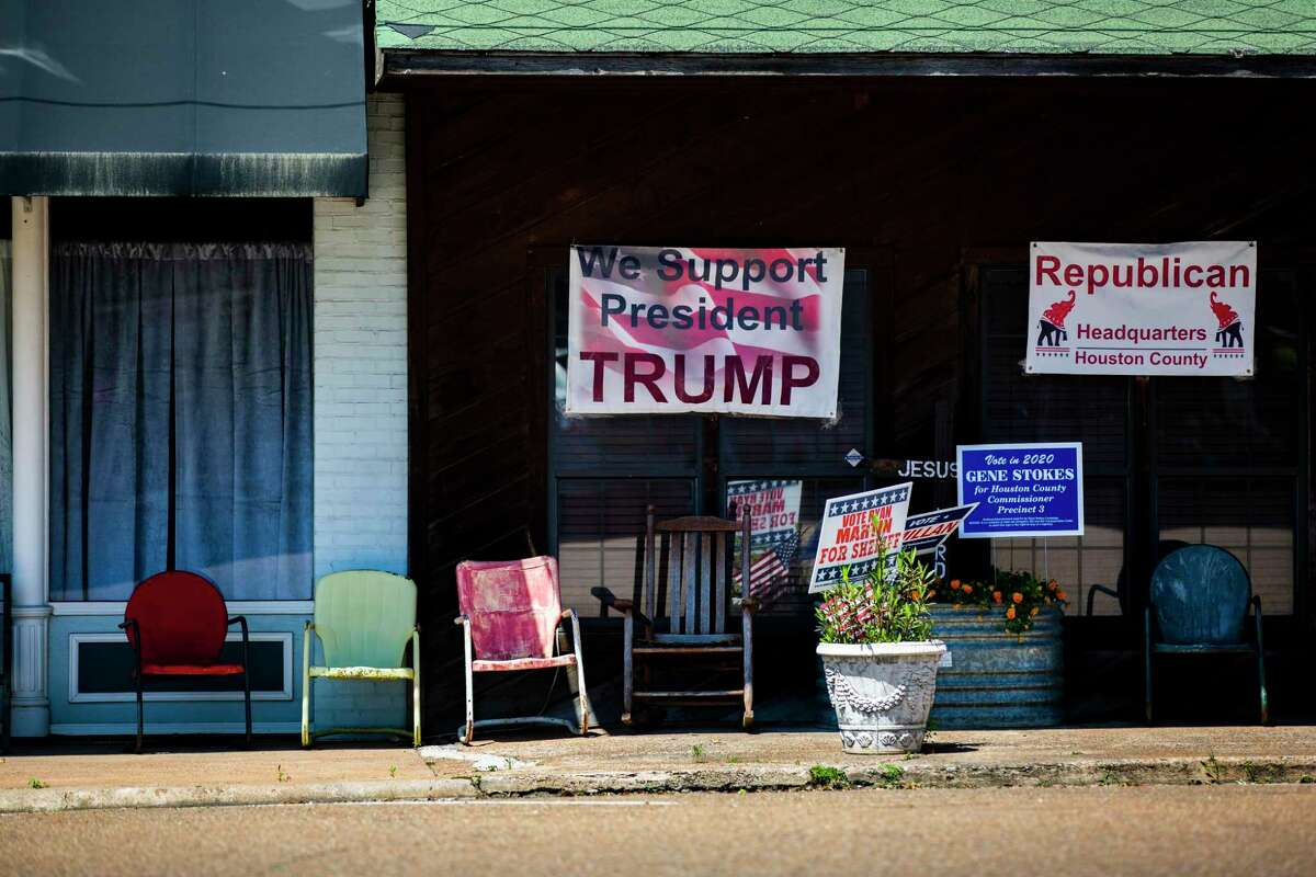 A sign supporting President Donald Trump hangs in front of the Republican Party headquarters in Crockett on Monday, April 13, 2020.