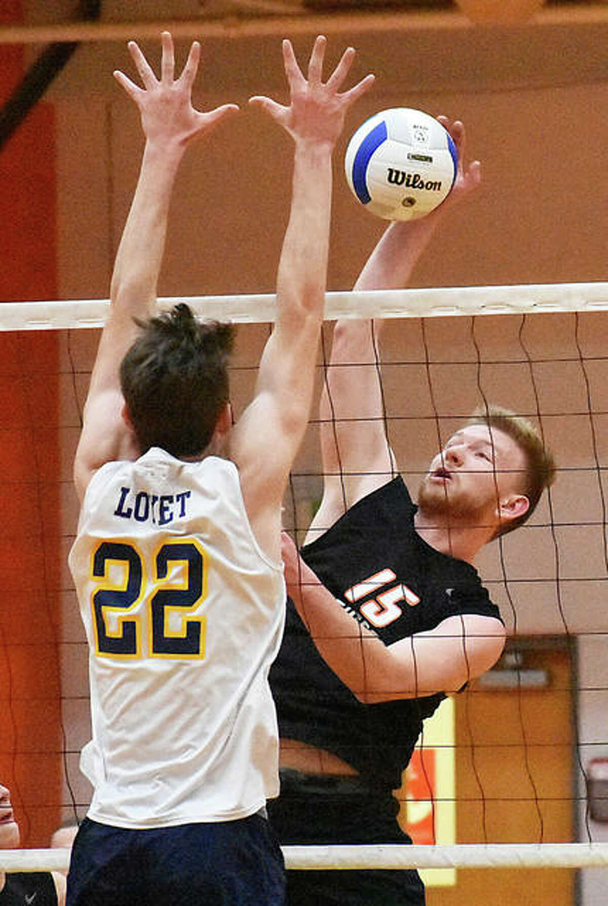 The Edwardsville boys volleyball team in action last season. The Tigers won a share of the Southwestern Conference championship and claimed a regional championship.