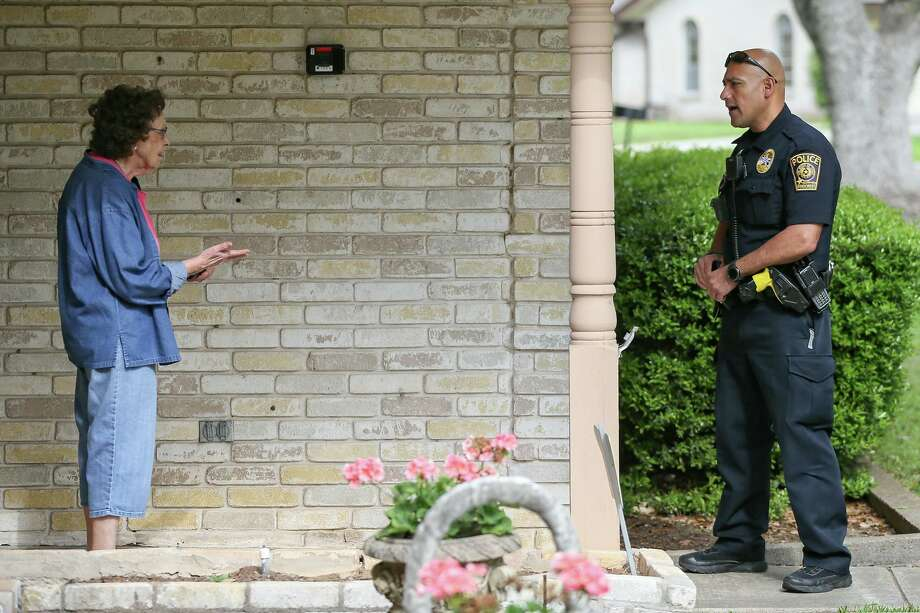 Windcrest Police Department patrolman Mark Dumas on Friday visits with a senior citizen as part of the department's senior welfare check program that has officers conduct daily visits to elderly residents whose names have been submitted to the department for the routine check-ins. Photo: Marvin Pfeiffer /Staff Photographer / **MANDATORY CREDIT FOR PHOTOG AND SAN ANTONIO EXPRESS-NEWS/NO SALES/MAGS OUT/TV
