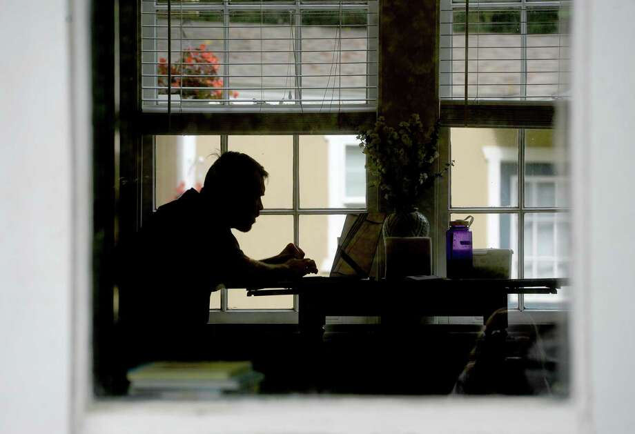An employee works from home during the COVID-19 pandemic. Photo: File Photo / BEN